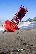 Ocean Waves Photos - Red bell buoy on beach with bottle by Garry Gay