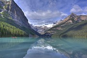 Canoe Photo Prints - Red Canoe On Lake Louise Print by Larry Whiting