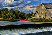 Canoe Waterfall Prints - Red Canoes at the Boathouse Print by Paul Ward