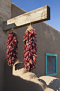 Taos Prints - Red Chili Peppers Hanging Outdoors Print by Bryan Mullennix