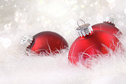 December Art - Red christmas balls in white feathers  by Sandra Cunningham