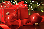 Giving Photos - Red Christmas gift with ornaments  by Sandra Cunningham