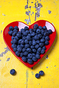 Ripe Posters - Red heart plate with blueberries Poster by Garry Gay