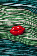 Yarn Prints - Red lips button on thread Print by Garry Gay