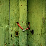 Green Door Prints - Red padlock Print by Bernard Jaubert