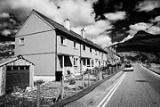 Pap Prints - Red Painted Wooden Clad Houses On The Main Street In Glencoe Highlands Scotland Uk With The Pap Of G Print by Joe Fox