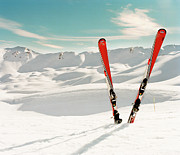 Getting Away Prints - Red Pair Of Ski In Snow Print by Muriel de Seze