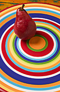 Ripe Posters - Red pear on circle plate Poster by Garry Gay