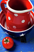 Wooden Table Prints - Red pitcher and tomato Print by Garry Gay