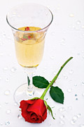 Sparkling Wine Photo Posters - Red rose and a glass of champagne Poster by Richard Thomas