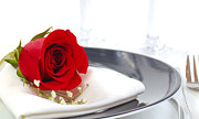 Champagne Glasses Photos - Red rose on a dinner plate by David Smith