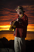 David Lade Posters - Red sky guitarist Poster by David Lade