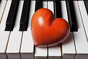 Romance Framed Prints - Red stone heart on piano keys Framed Print by Garry Gay
