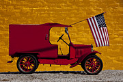 Wheels Art - Red truck against yellow wall by Garry Gay