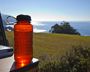 Day Trip Framed Prints - Red Water Bottle with Ocean in Background Framed Print by David Buffington