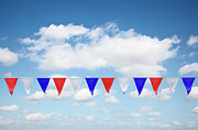 White Pennant Prints - Red, White And Blue Bunting Against A Blue Sky Print by Jon Boyes