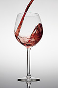 Wine Flowing Prints - Red Wine Being Poured Into A Glass Print by Dual Dual