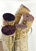 Red Wine Glass Photos - Red wine corks by Frank Tschakert