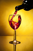 Wine Pour Posters - red Wine Filling the glass Poster by Jesus Cervantes