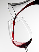 Pouring Wine Framed Prints - Red Wine Pouring Into Glass From Decanter Framed Print by Roger Méndez Fotografo, S.L.