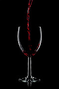 Red Wine Glass Photos - Red wine pouring by Richard Thomas