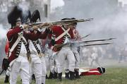 Historical Reenactments Photos - Redcoats Shoot Muskets In A Reenactment by Ira Block