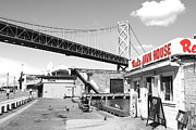 Baybridge Framed Prints - Reds Java House and The Bay Bridge in San Francisco Embarcadero . Black and White and Red Framed Print by Wingsdomain Art and Photography