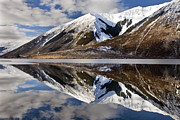 Snow-covered Landscape Photo Prints - Reflection In Lake Pearson, Castle Hill Print by Colin Monteath