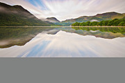 Blurred Motion Framed Prints - Reflection Of Mountains And Trees On Lake Framed Print by John Ormerod