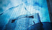 Property Prints - Reflection Of Skyscraper  Print by Setsiri Silapasuwanchai