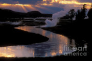 Crepuscular Rays Photos - Reflections On The Firehole River by Sandra Bronstein