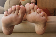 Sexy Soles Photos - Relaxing on the couch  by Tos Photos