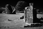 Historic Ruins Framed Prints - Remains Of The 6th Century Round Tower And Reconstructed Sundial On The Monastic Site At Nendrum  Framed Print by Joe Fox