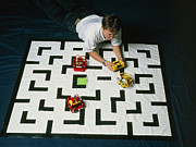 Lego Photo Prints - Researcher Testing Lego Robots Playing Pacman Print by Volker Steger