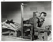 Laboratories Prints - Researcher Tests A Pilots Bed Print by U.S. Gov