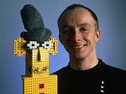Lego Photo Prints - Researcher With His Happy Emotional Lego Robot Print by Volker Steger