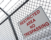 Tilted Posters - Restricted Area Sign on Barbed Wire Fence Poster by David Buffington