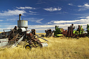 Urban Scenes Prints - Retired Combines Rust In A Prairie Print by Pete Ryan