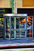 Door Reflections Posters - Revolving Doors Poster by Jill Battaglia