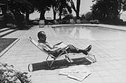San Clemente Photo Prints - Richard Nixon Reading Newspapers While Print by Everett