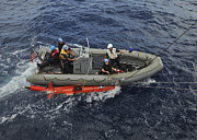 Inflatable Photos - Rigid-hull Inflatable Boat Operators by Stocktrek Images
