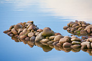 Reflective Water Photos - River Rocks by Bonnie Bruno