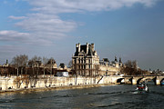 River. Clouds Prints - River View in Paris Print by John Rizzuto