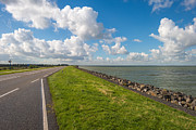 Flevoland Framed Prints - Road on a dike along a lake Framed Print by Jan Marijs