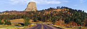 Secluded Mountain Landscape Prints - Road to Devils Tower Crossing Belle Fourche River Print by Jeremy Woodhouse