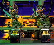 Electronic Photos - Robot Hands Soldering Components To Circuit Boards by Tek Image