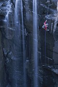 Endurance Sports Prints - Rock Climbing Alongside A Waterfall Print by John Burcham