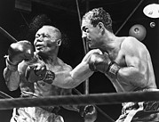 Sweating Framed Prints - Rocky Marciano Landing A Punch Framed Print by Everett