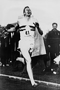 British Portraits Photo Prints - Roger Bannister Crossing The Finish Print by Everett