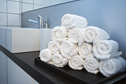 Public Restroom Prints - Rolled Towels Stacked In The Shape Of A Pyramid Print by Larry Washburn